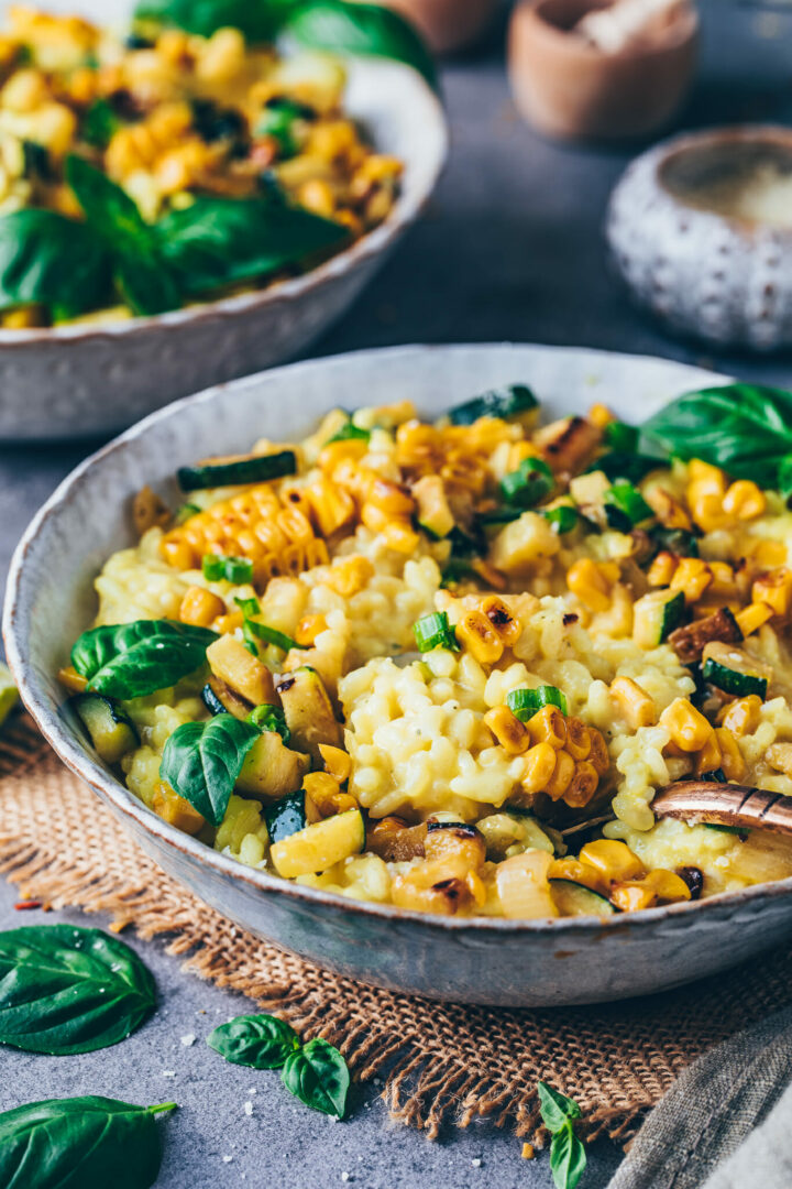 corn risotto with zucchini, basil and vegan parmesan cheese