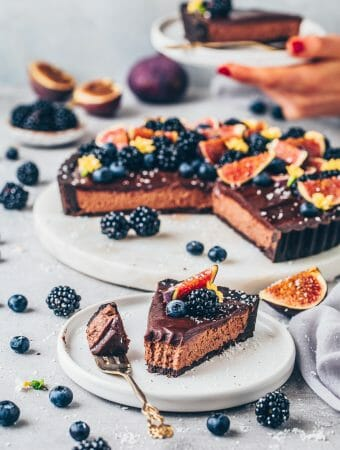 chocolate mousse pie vegan no bake tart with chocolate ganache, figs, blackberries and blueberries