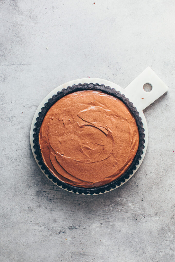 Oreo cookie pie crust with chocolate mousse in a tart pan