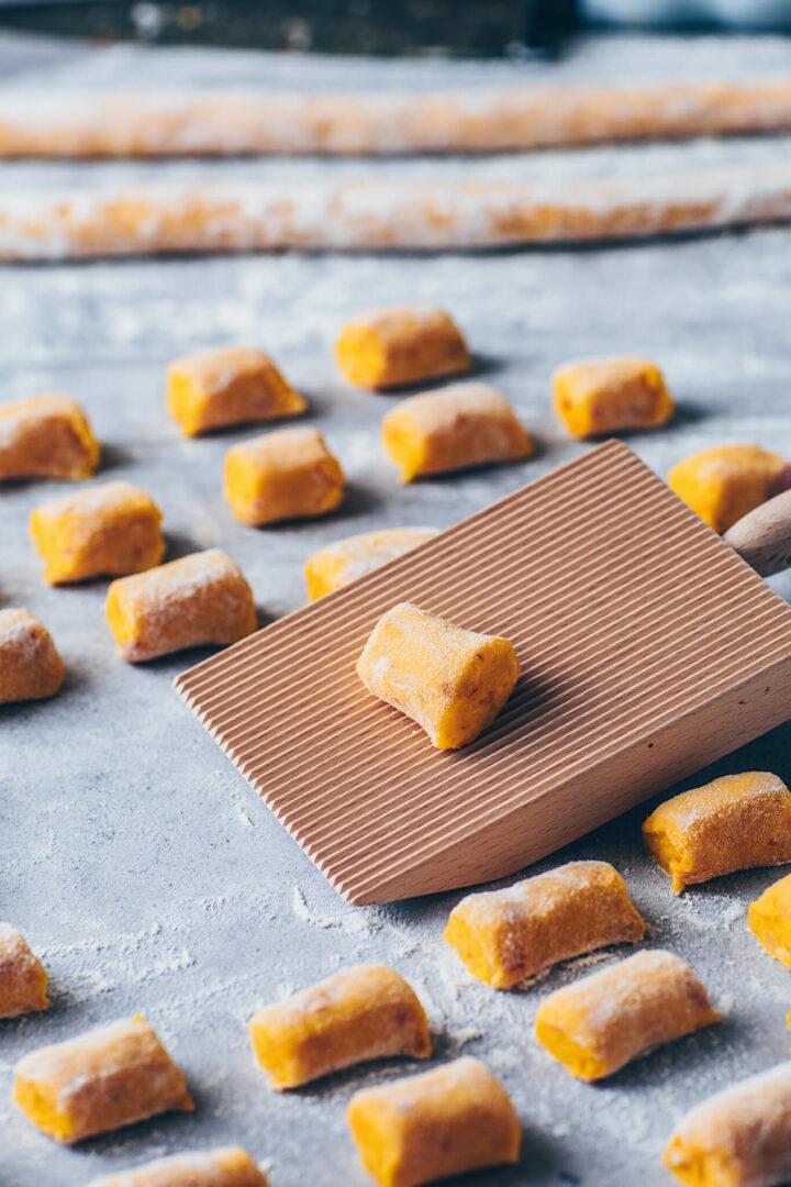 pumpkin potato dumplings on a gnocchi board