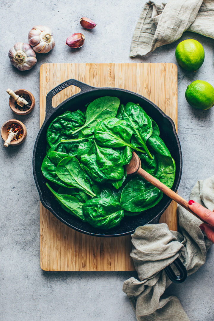 fresh spinach in a skillet with garlic