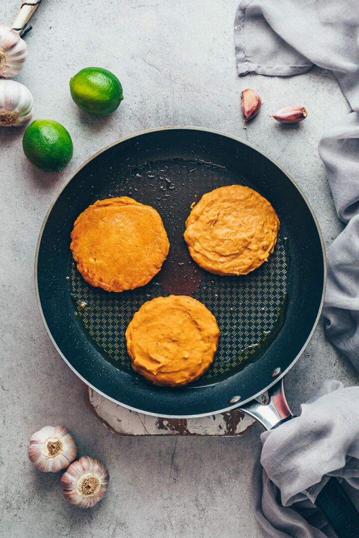 mashed sweet potato cakes in a skillet