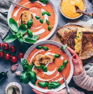 creamy tomato soup from scratch with fresh tomatoes, vegan parmesan, basil, grilled cheese sandwich