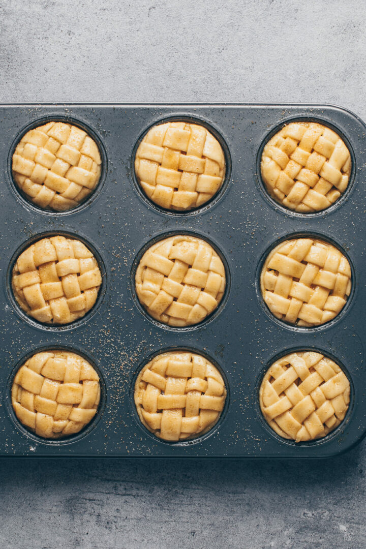 mini apple pies with lattice top crust in muffin pans