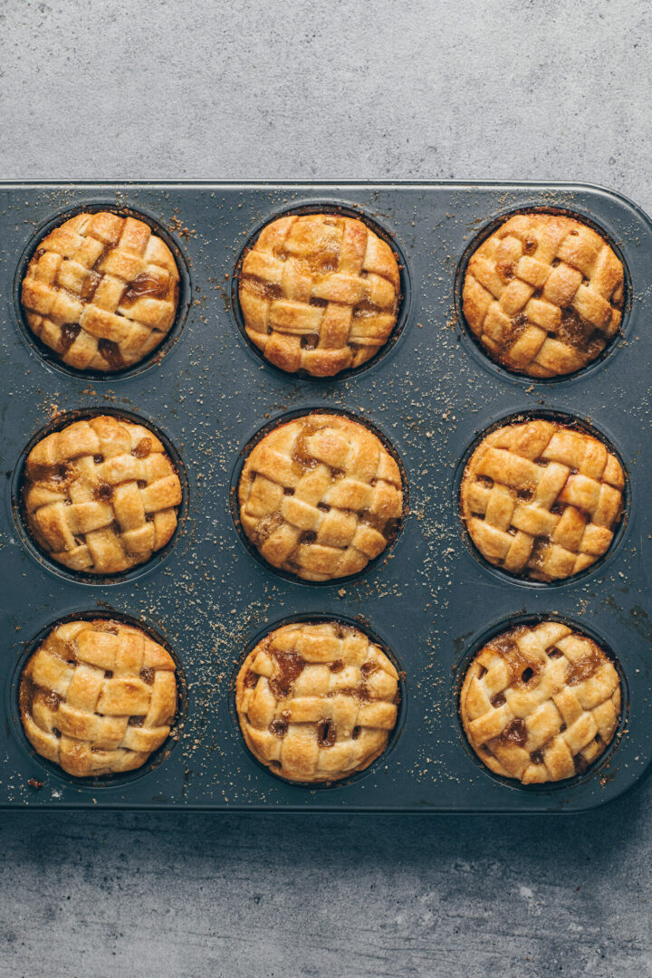 crispy mini apple pies with lattice top crust in muffin pans