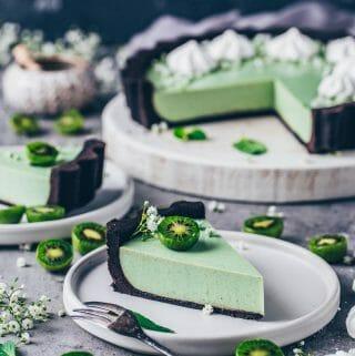 matcha cheesecake tart with oreo cookie crust and kiwi meringue decoration