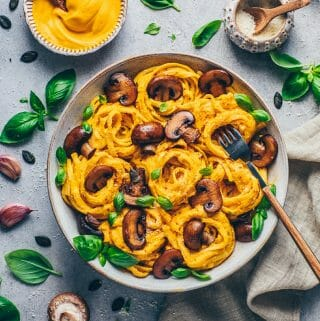 Creamy Pumpkin Pasta with Cheese Sauce, Mushrooms, parmesan, and basil