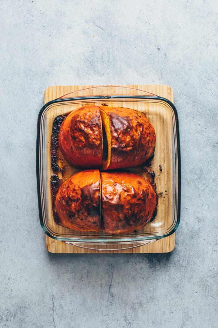 roasted pumpkin in a baking dish to make pumpkin puree