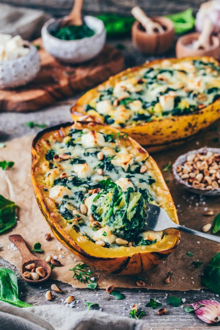 spaghetti squash noodles stuffed with garlic spinach cream, feta cheese and toasted pine nuts