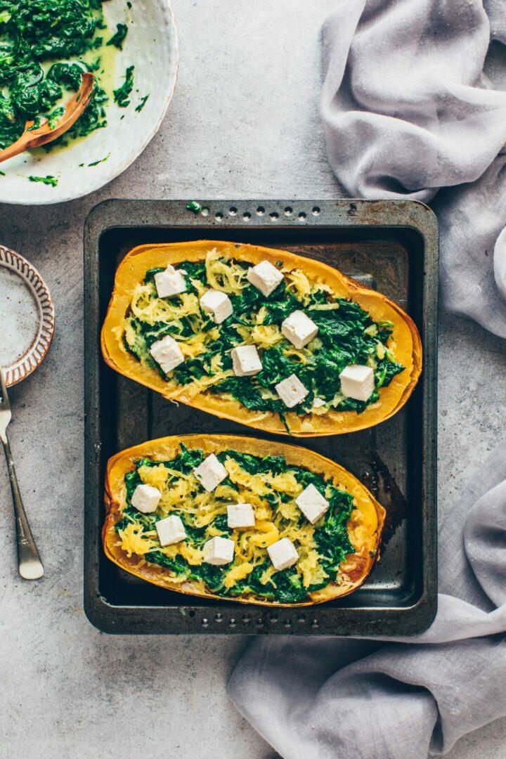 spaghetti squash boats with spinach cream and vegan feta cheese