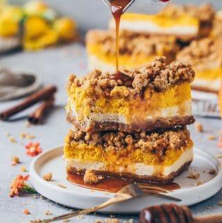 Pumpkin Cheesecake Bars with Cinnamon Streusel and Caramel Sauce