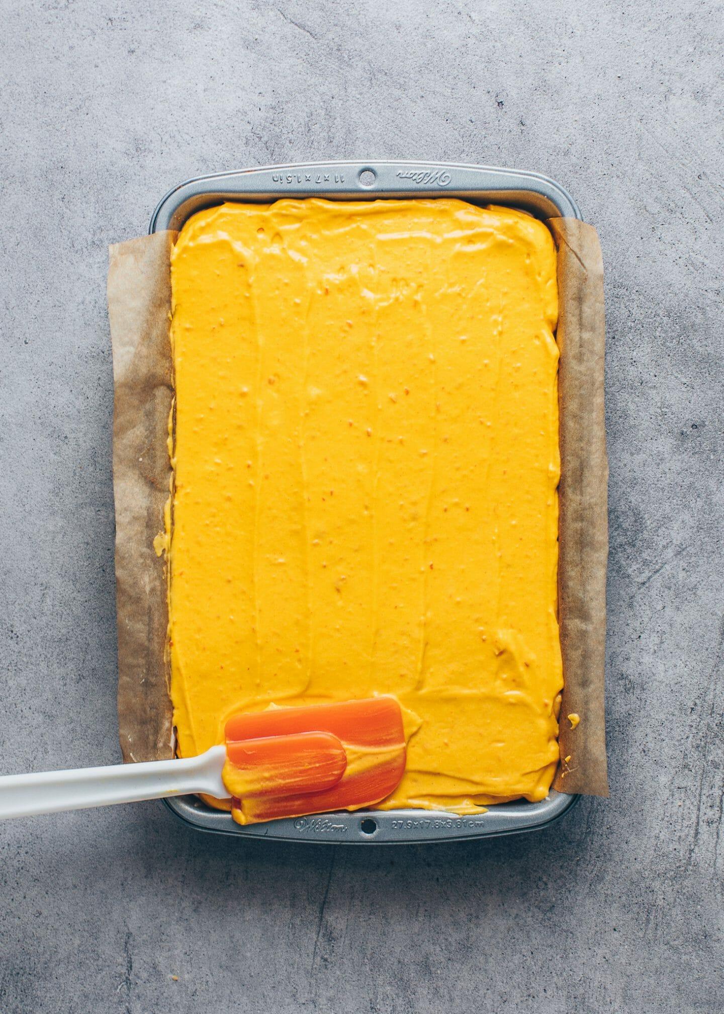 pumpkin cheesecake filling in a baking pan