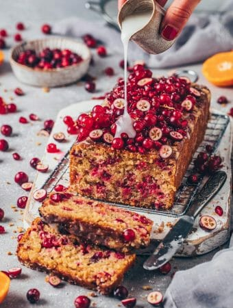 Cranberry Orange Bread, topped with red currants, pomegranate and orange glaze