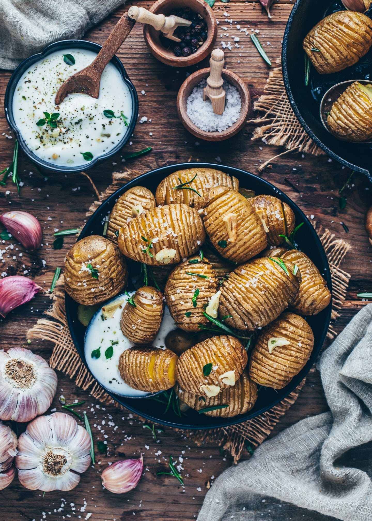 Crispy baked Hasselback Potatoes with garlic, rosemary, sea salt and sour cream dip
