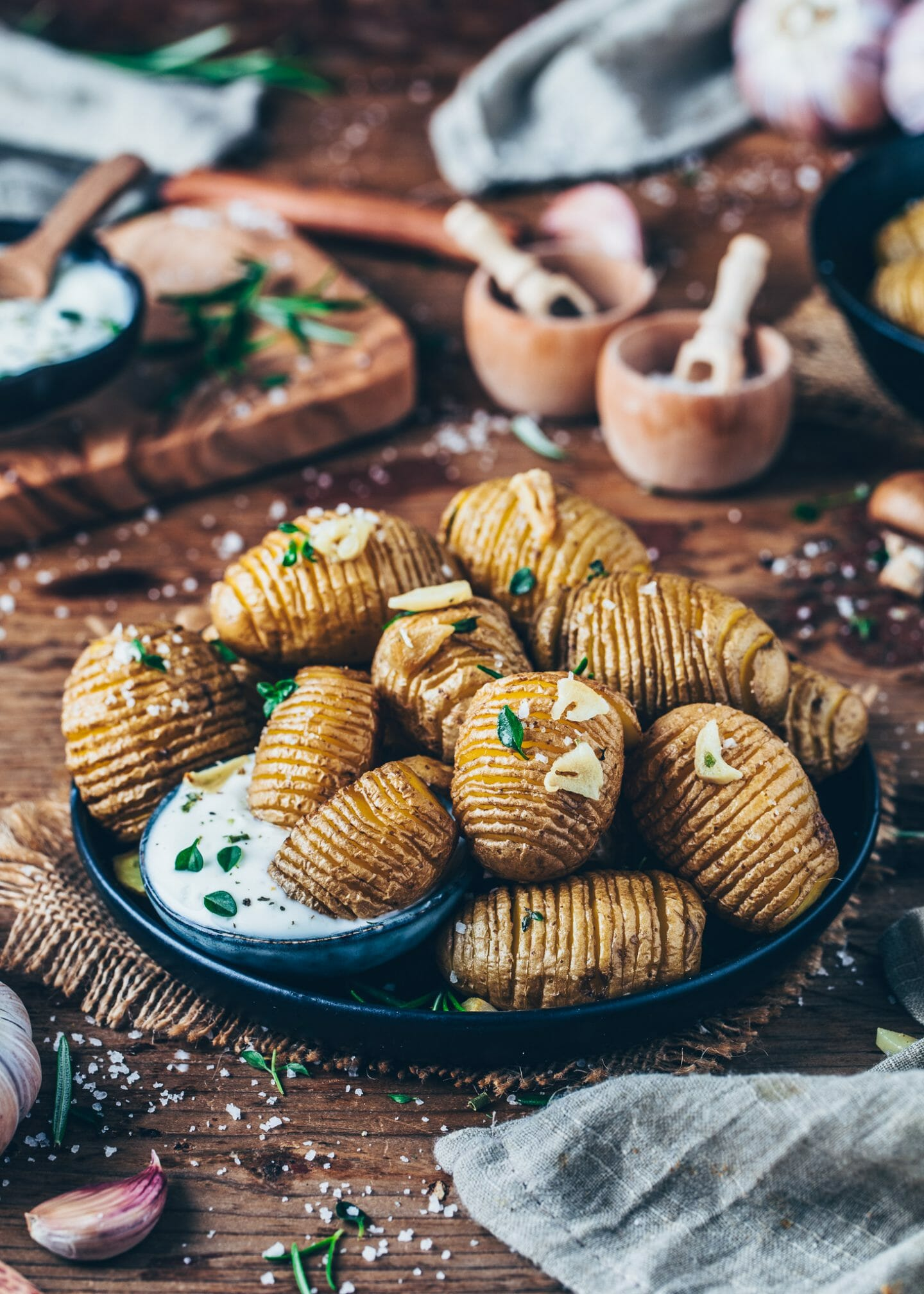 Hasselback Potatoes with garlic, rosemary, thyme and yoghurt dip