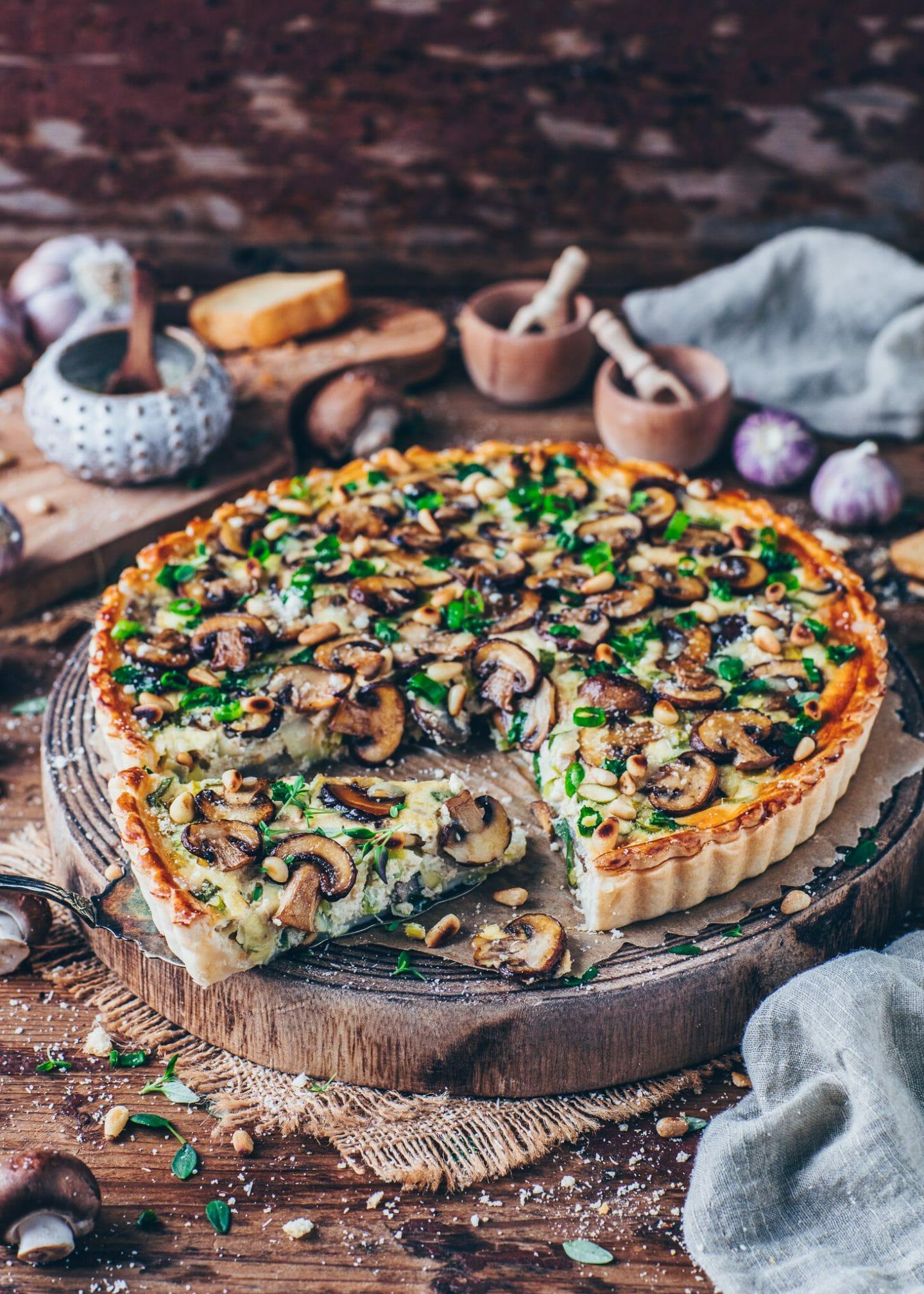 mushroom leek quiche tart with pine nuts and vegan parmesan cheese