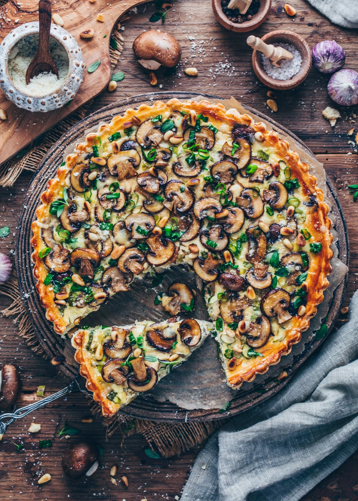 mushroom leek quiche tart with pine nuts and vegan parmesan cheese