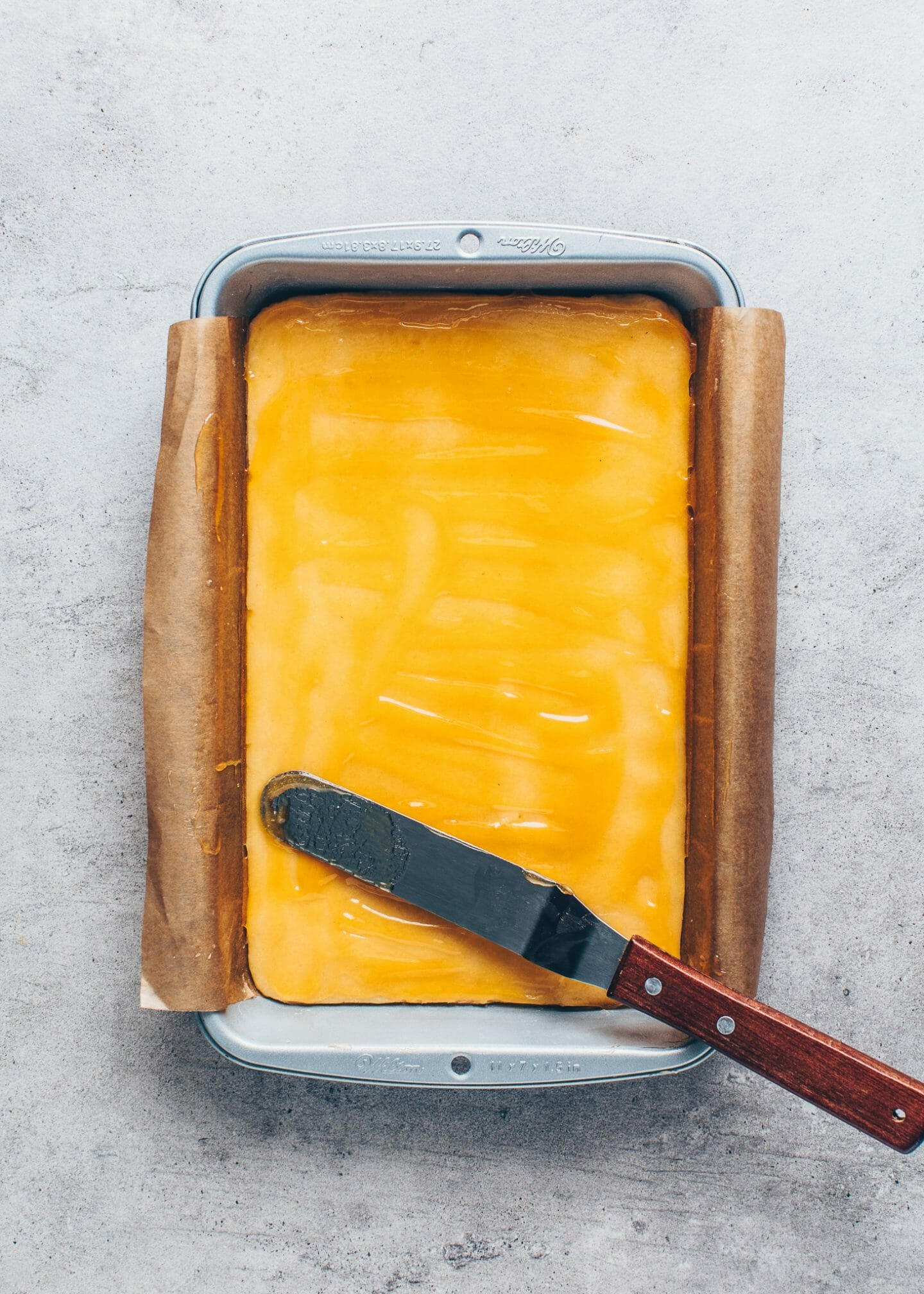 shortcrust pastry with apricot jam in a baking pan