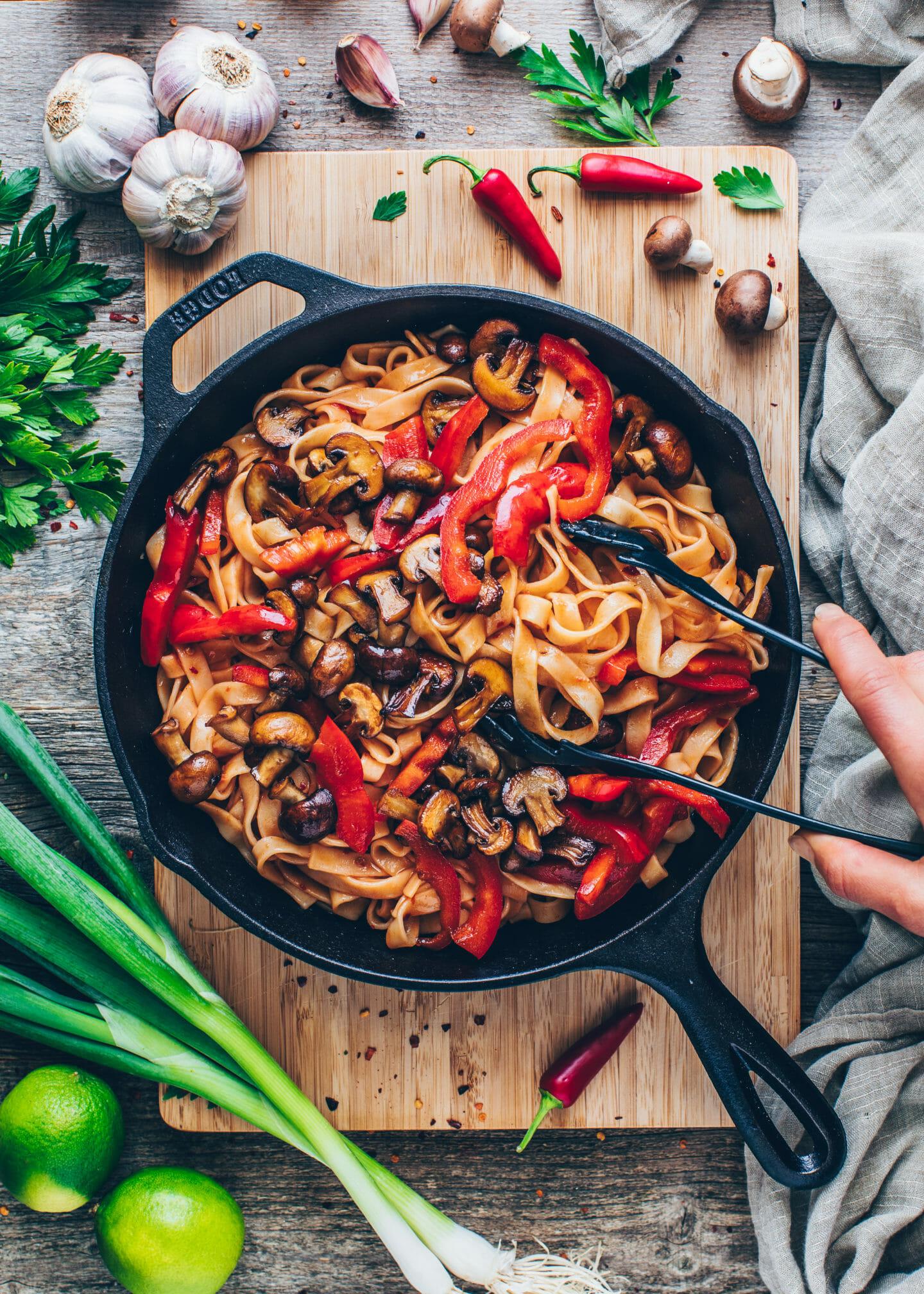 Mushrooms, bell pepper, garlic, and ginger for Thai noodle stir-fry