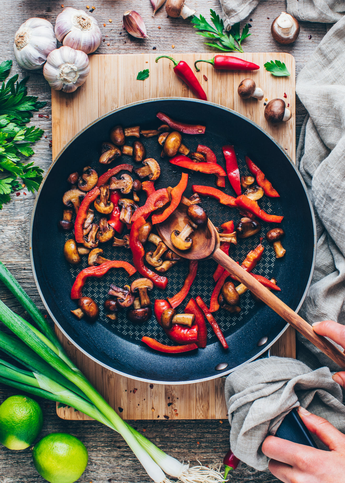 sauteed mushrooms, bell pepper, garlic, and ginger for Thai noodle stir-fry