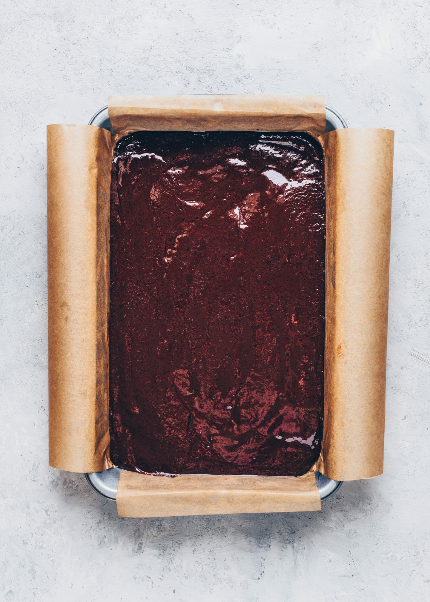 Brownie batter in a baking pan