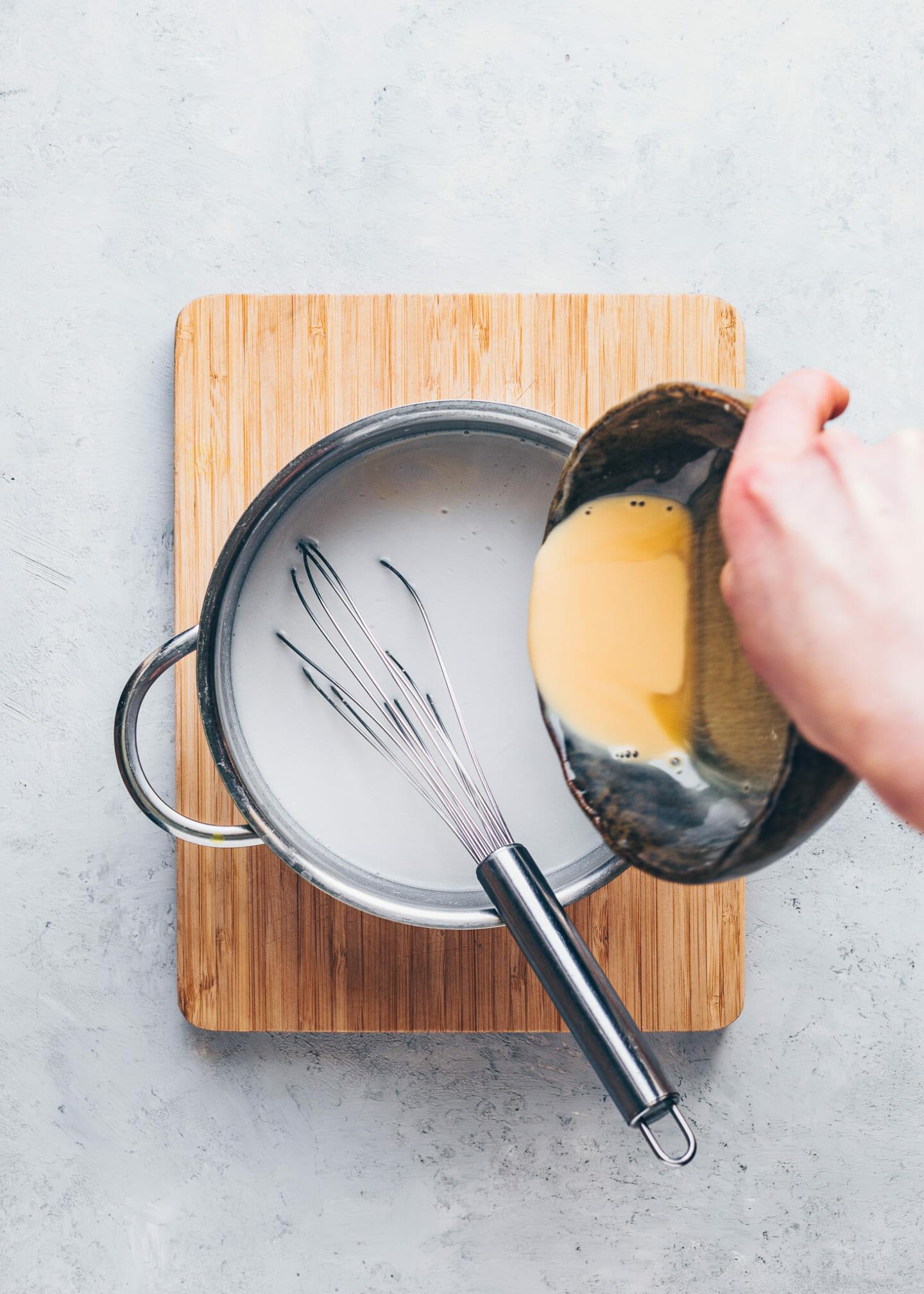 coconut milk in a saucepan to make custard