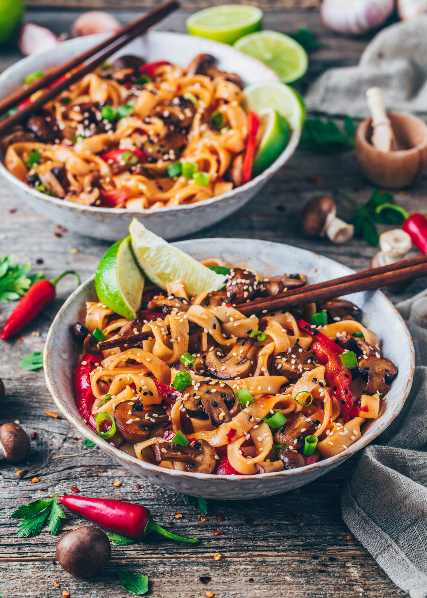 Asian Thai Noodles with mushrooms, garlic, chili, bell peppers, coconut milk, and limes