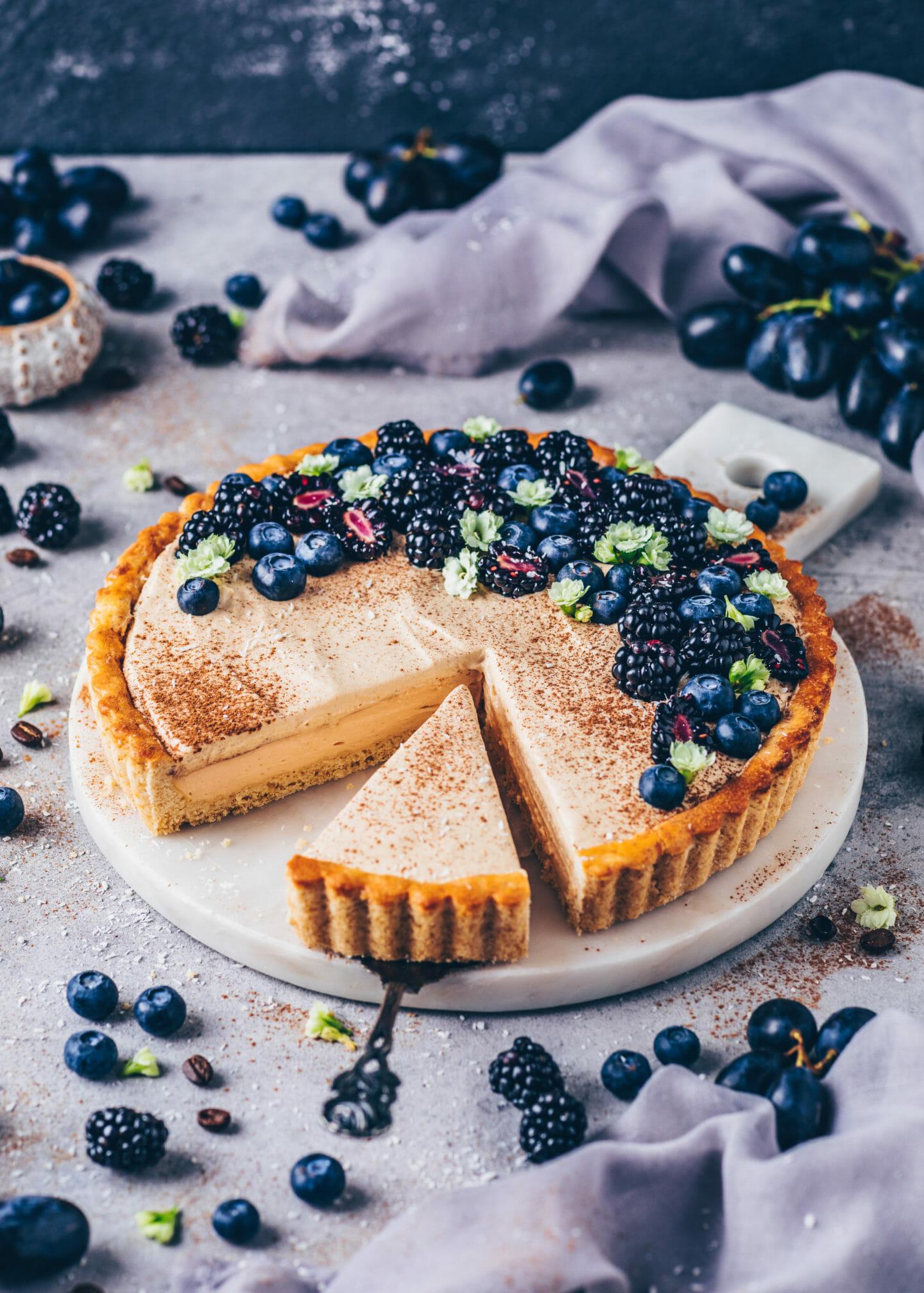 Vegan Milk Pudding Custard Tart with coffee mousse, blueberries and blackberries