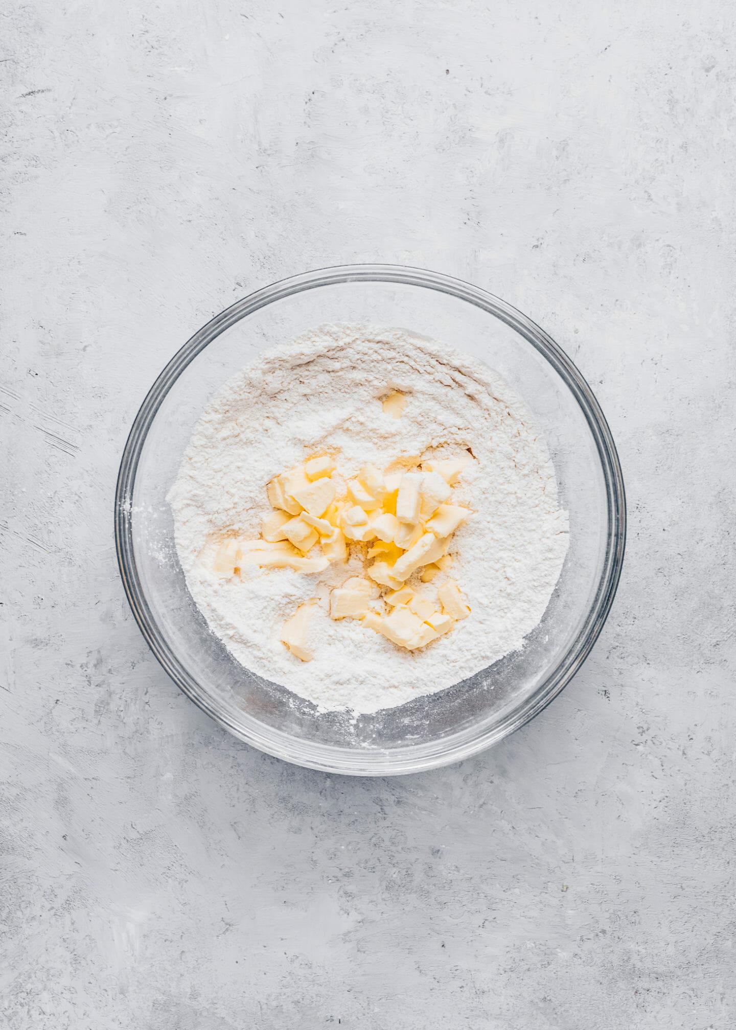 flour, salt, sugar and vegan butter in a bowl for homemade tart dough