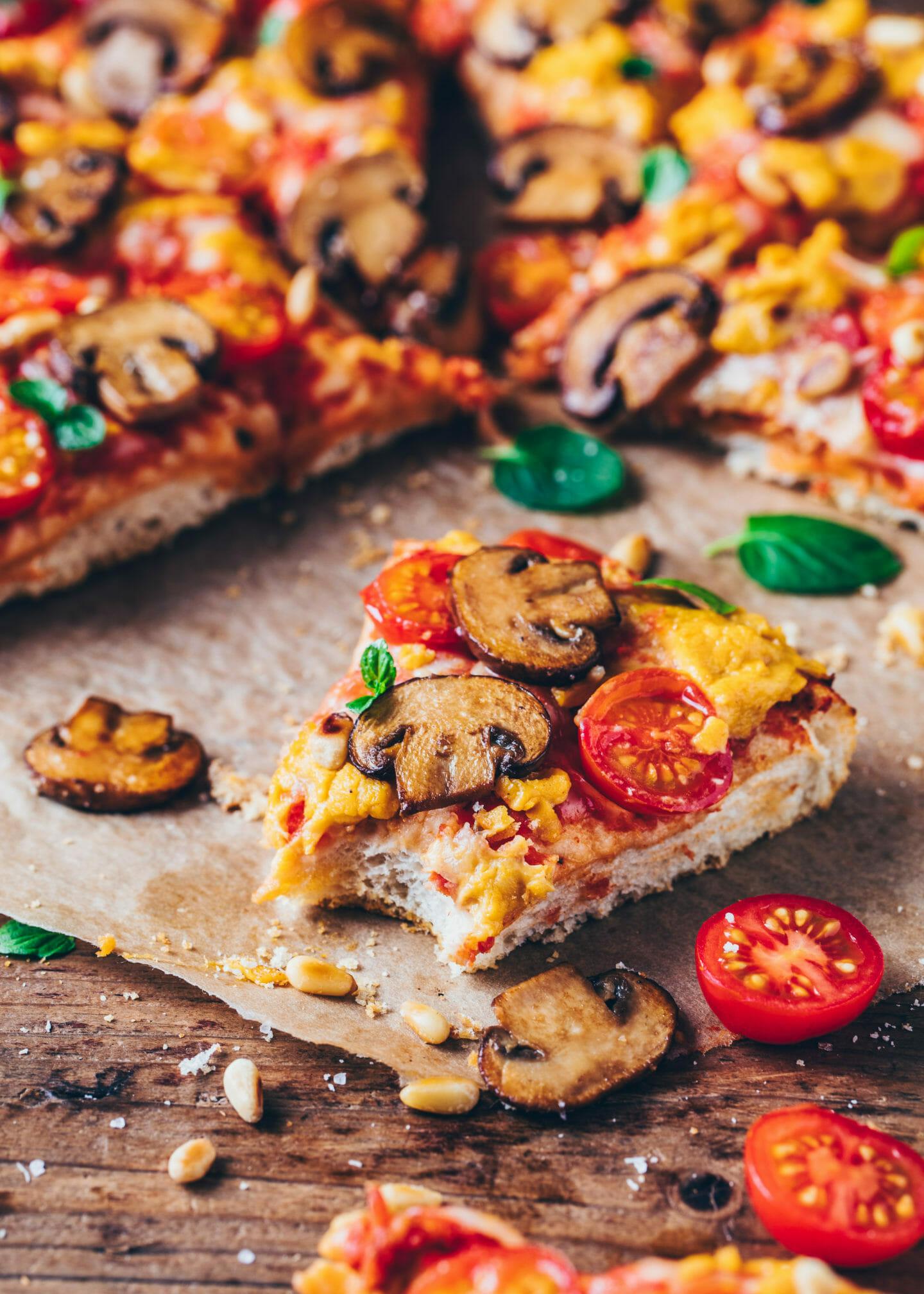 Tomato Mushroom Pizza with grated vegan cheese