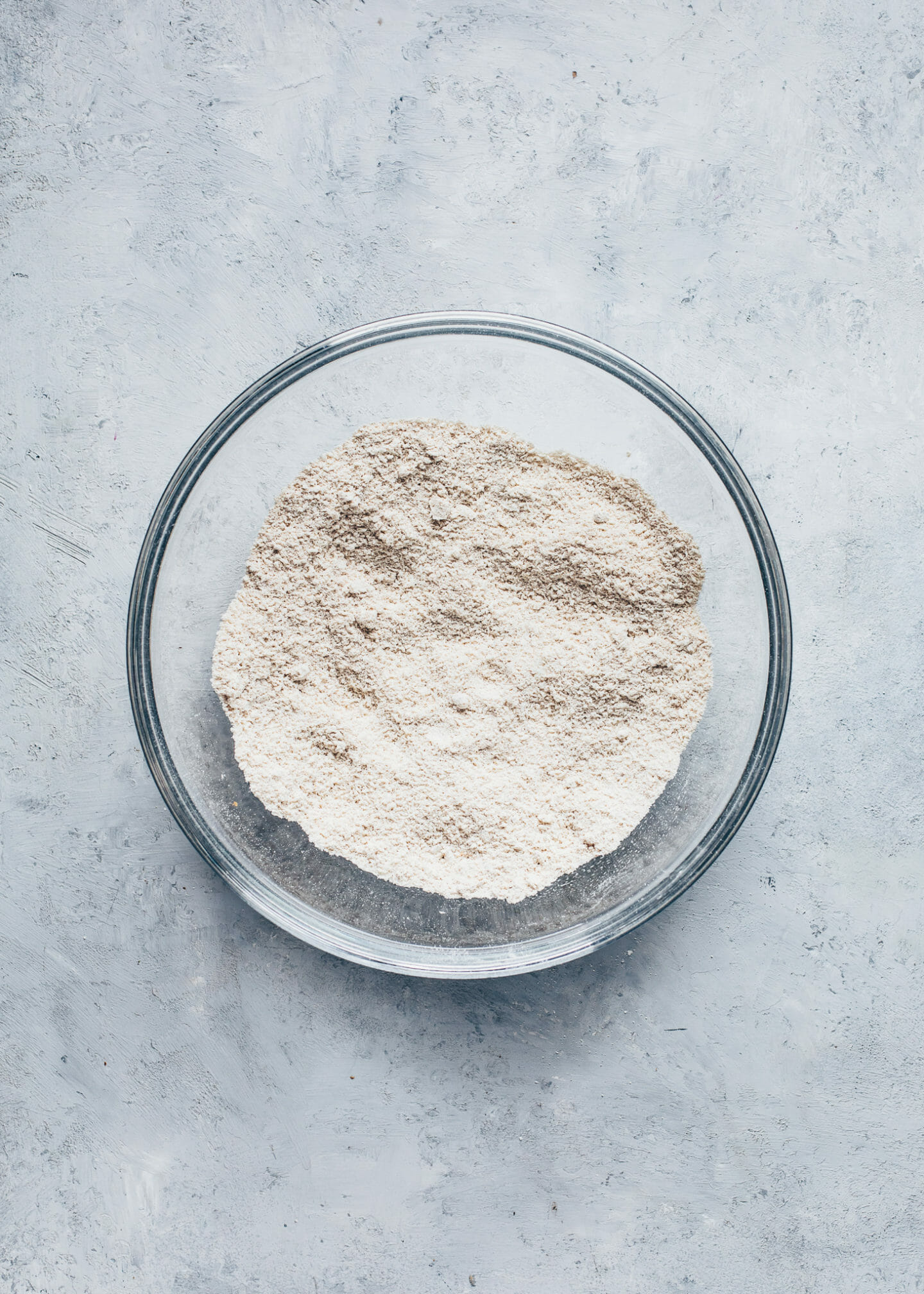 Oat flour and shredded coconut in a bowl for cookie crust
