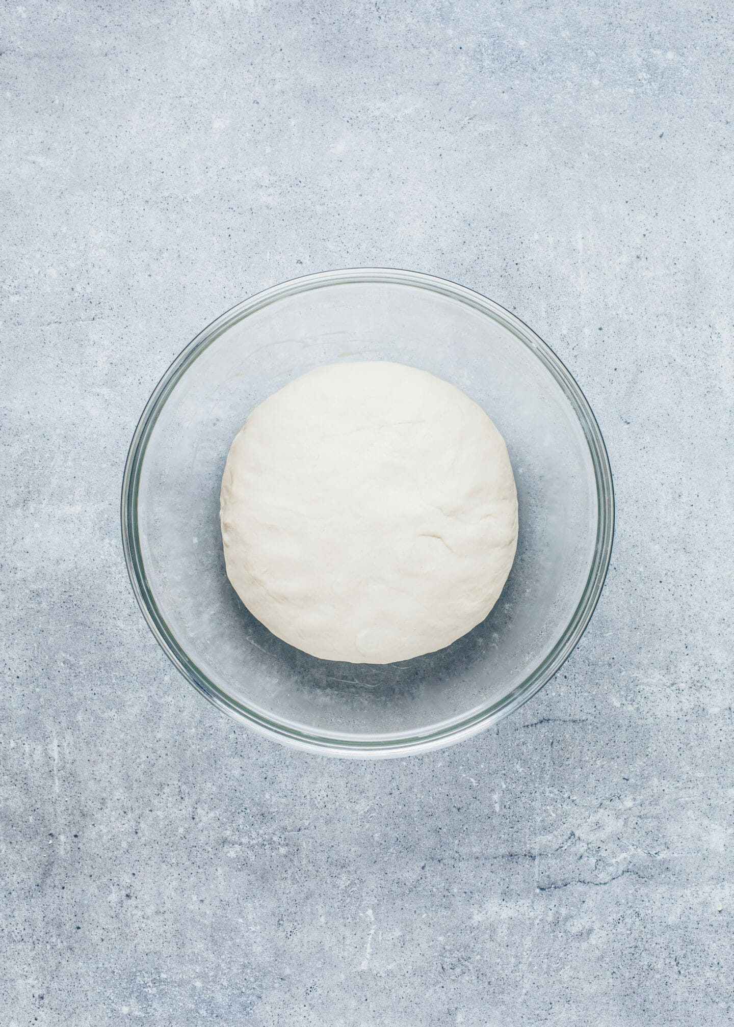yeast dough in a bowl to make focaccia bread