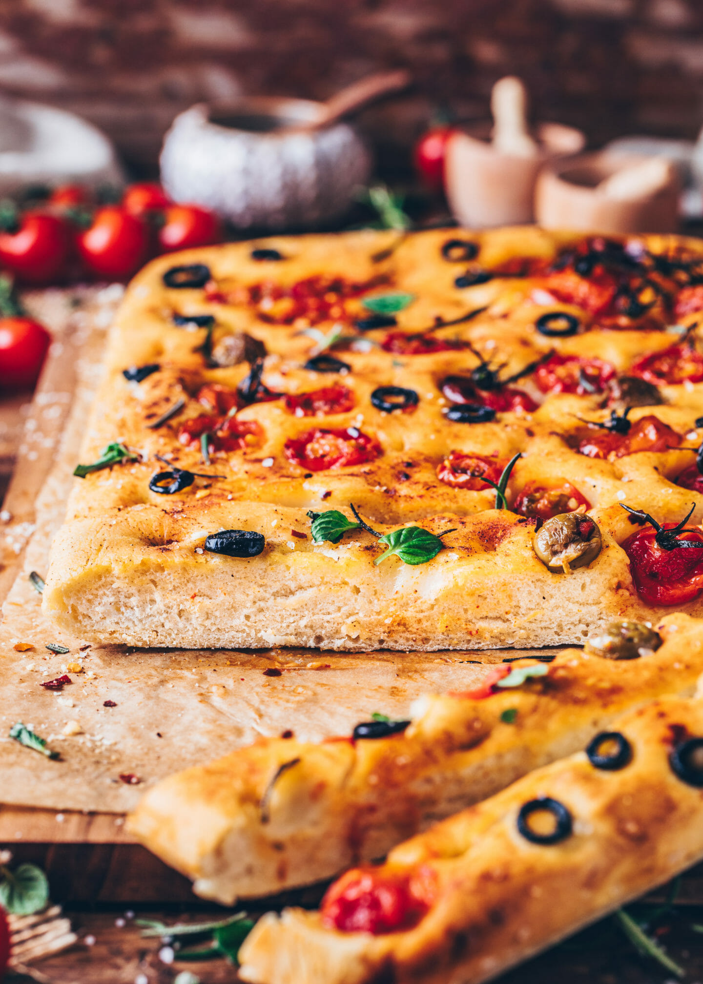 Focaccia with cherry tomatoes, olives, rosemary, and sea salt
