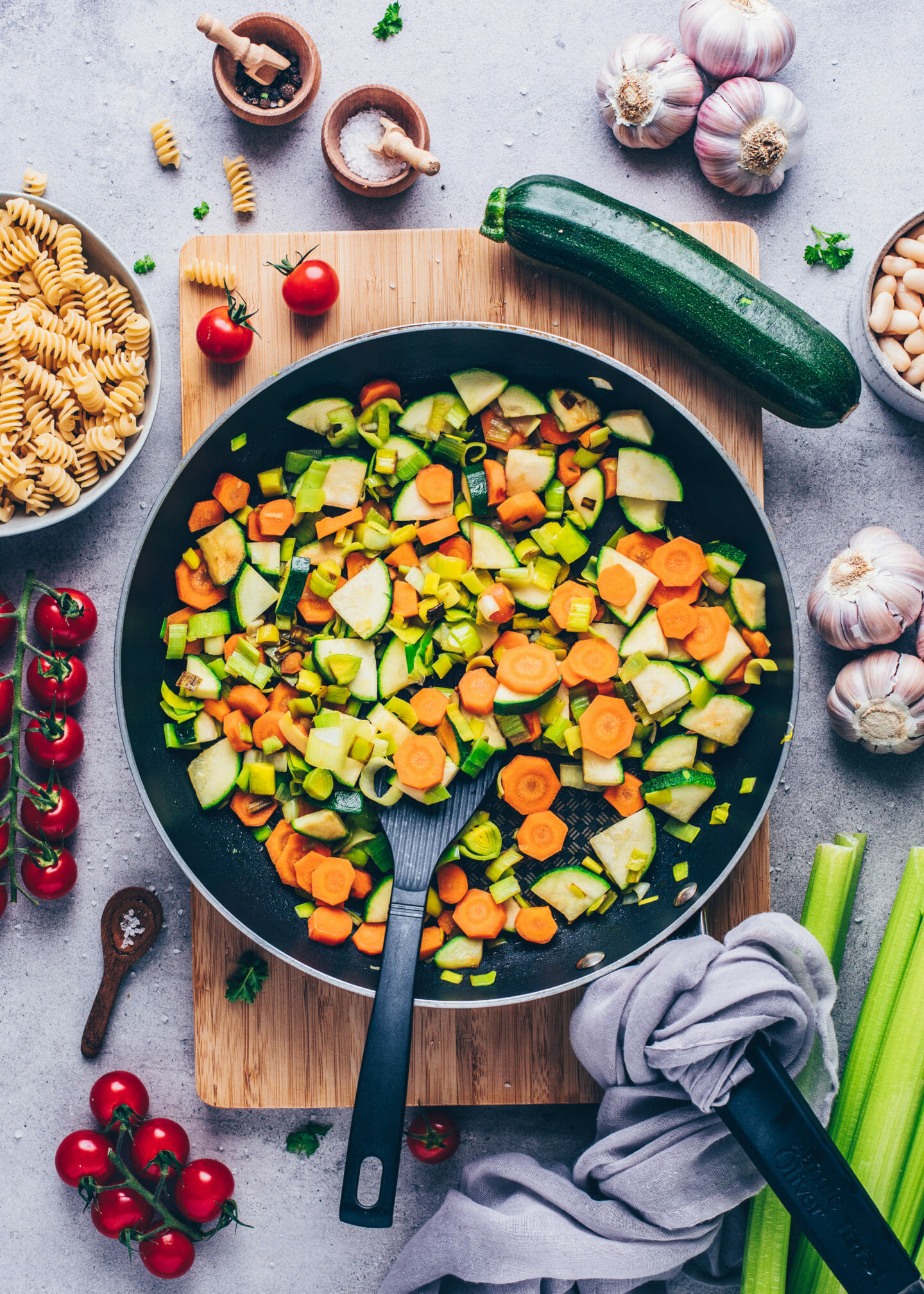 Sautéed vegetables in a pan for minestrone soup
