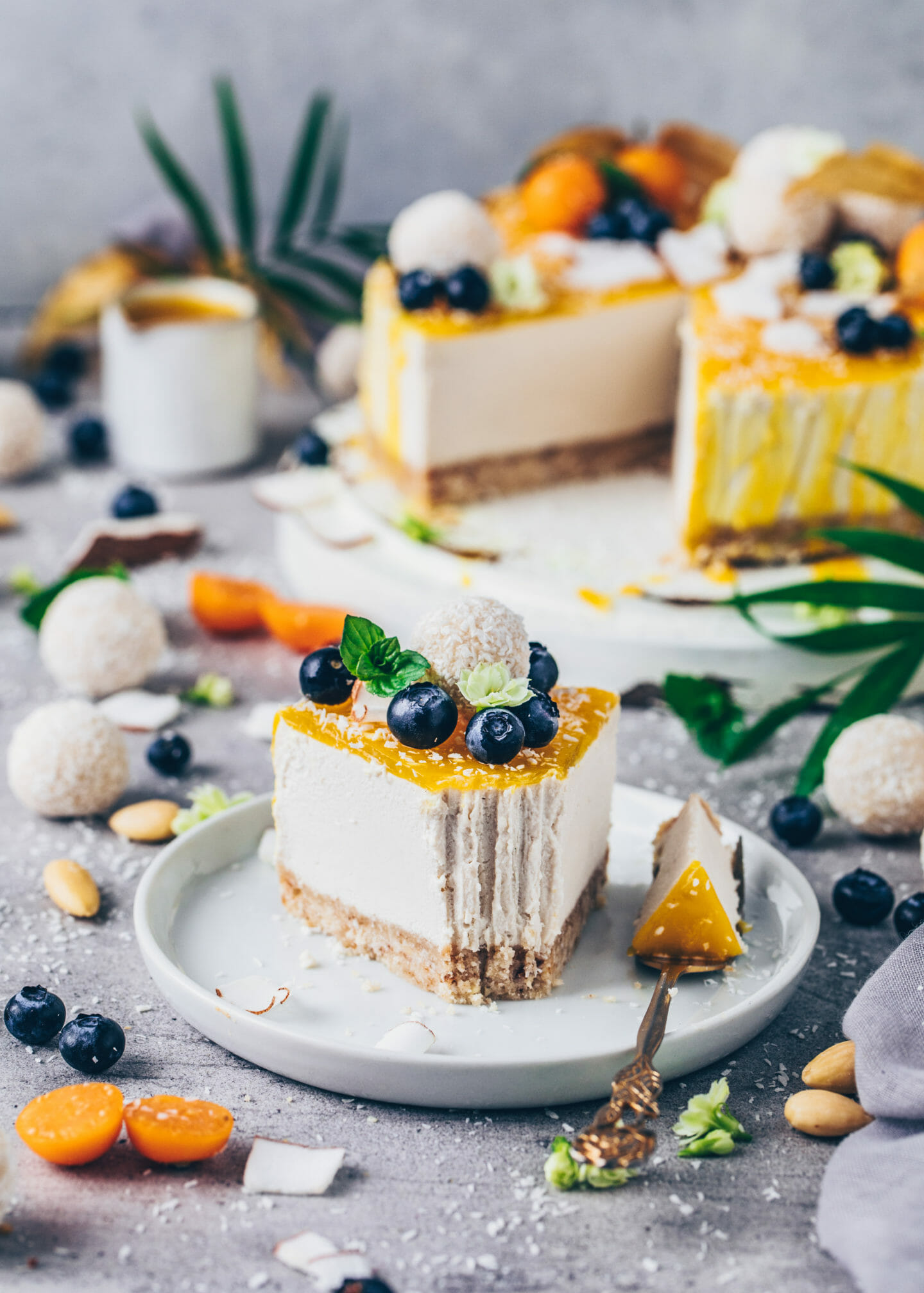 Raw Vegan Cheesecake with Raffaelo Coconut Balls, Mango and fruits