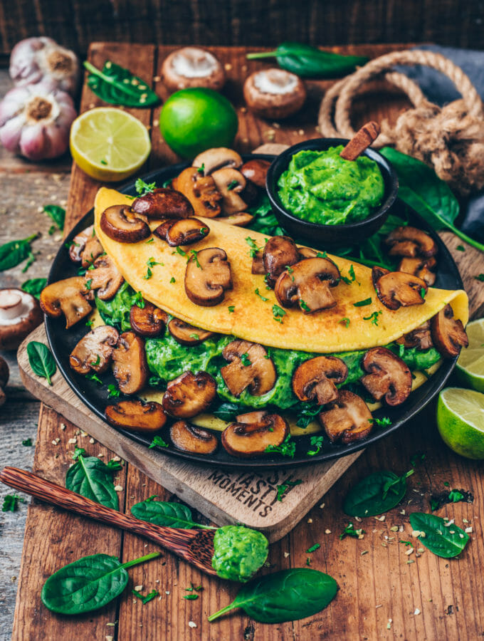 Vegan Omelet stuffed with avocado, spinach and garlic mushrooms