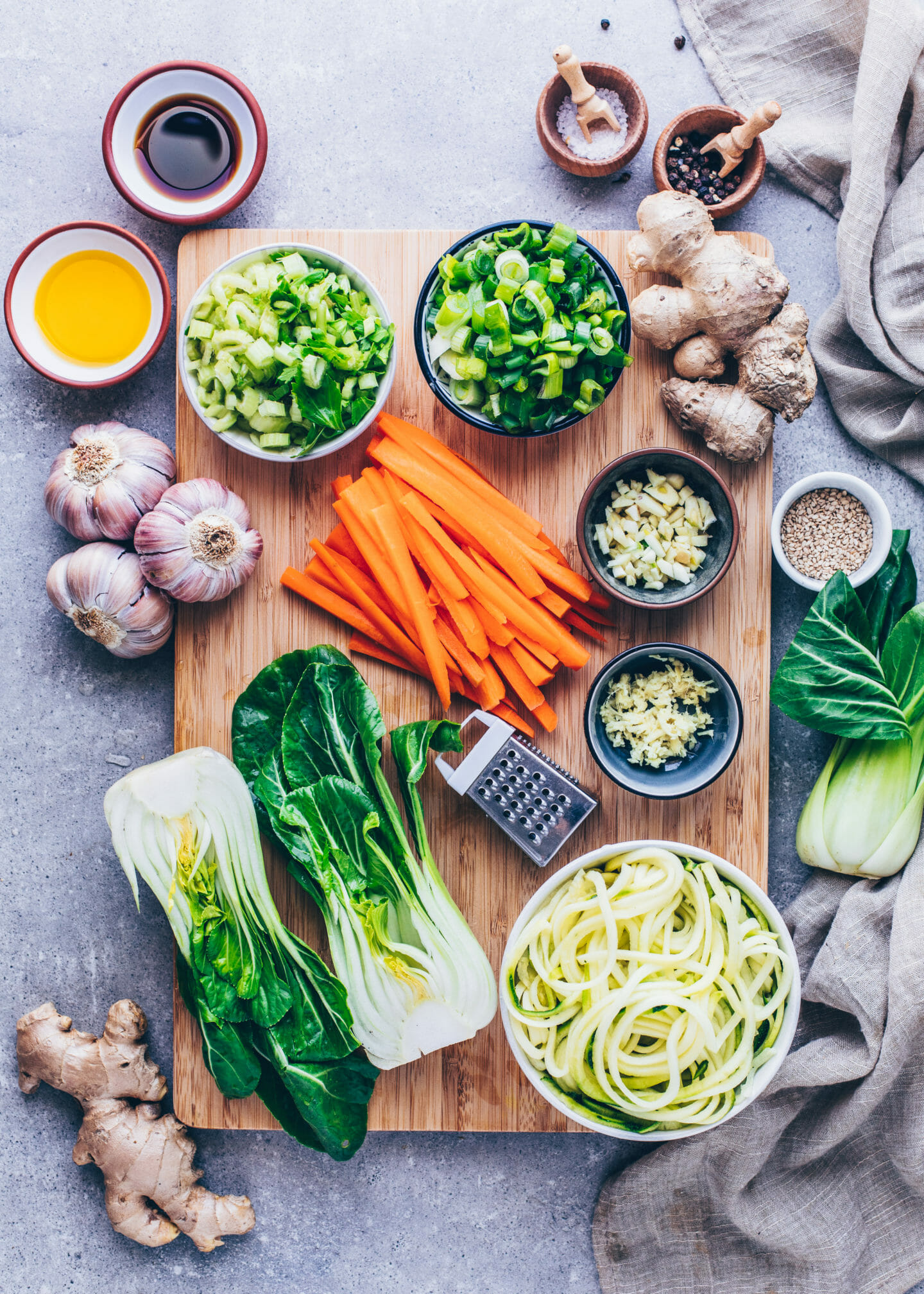 carrots, garlic, ginger, Bok Choy, zucchini, scallions, celery, oil, sesame for dumpling vegetable soup