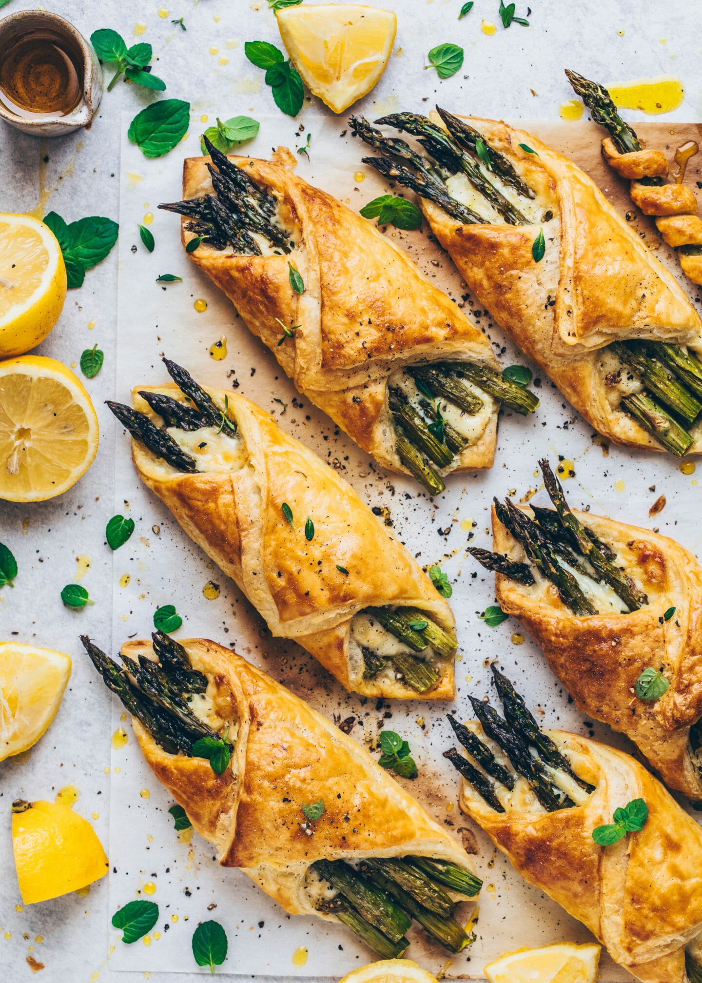 asparagus bundles and cheese wrapped in puff pastry with lemon on the side