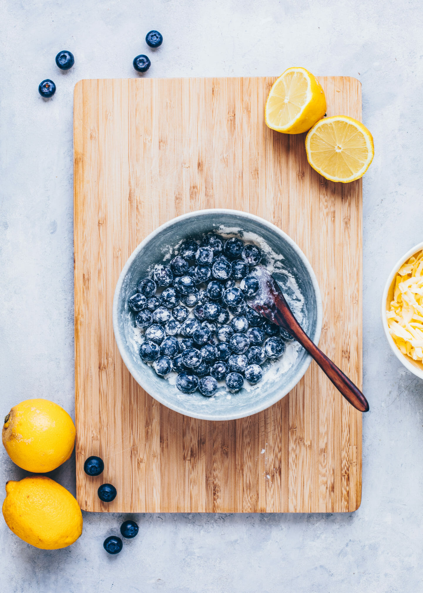 toss blueberries in cornstarch and flour