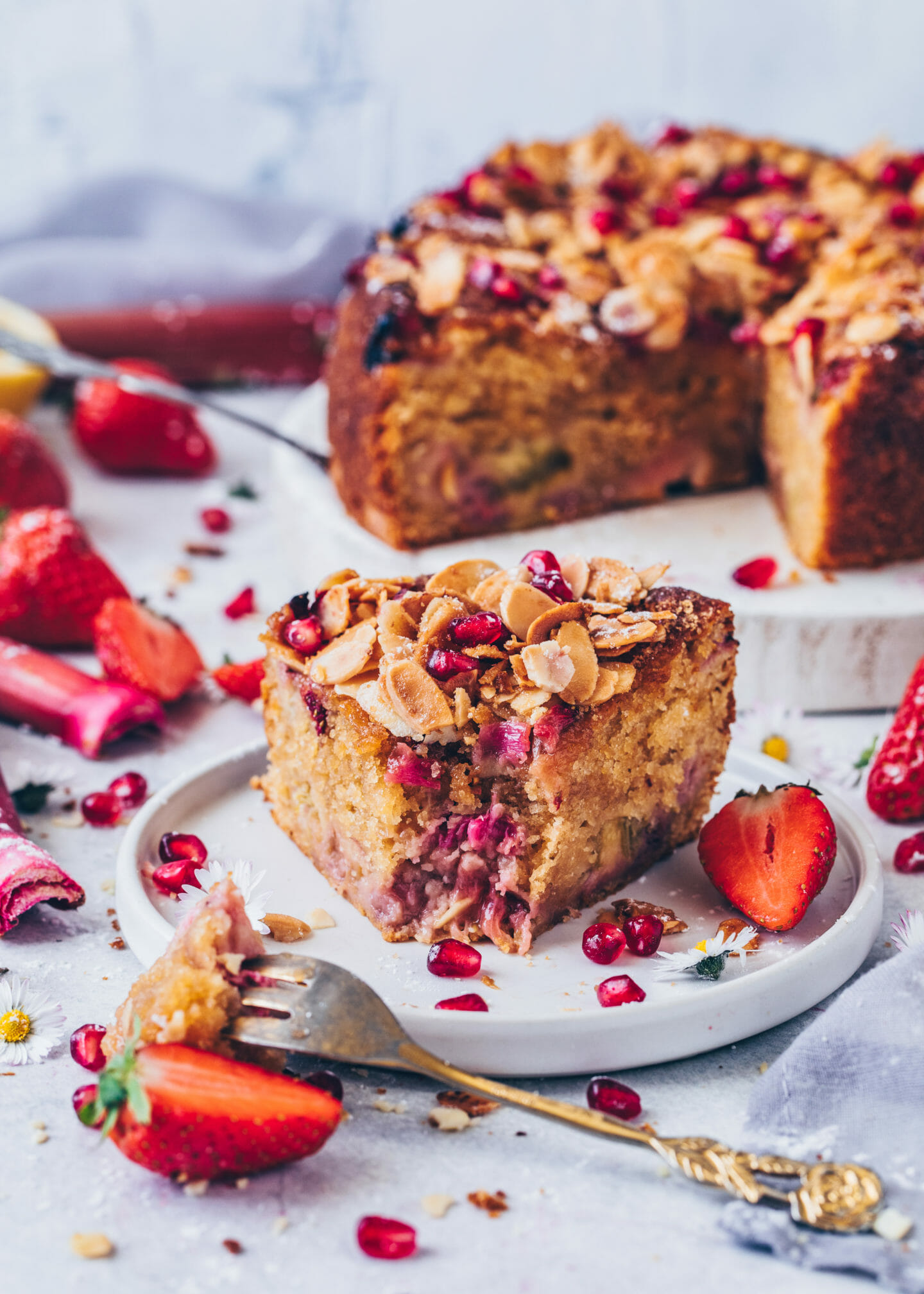 Strawberry Rhubarb Cake with Almonds and pomegranate