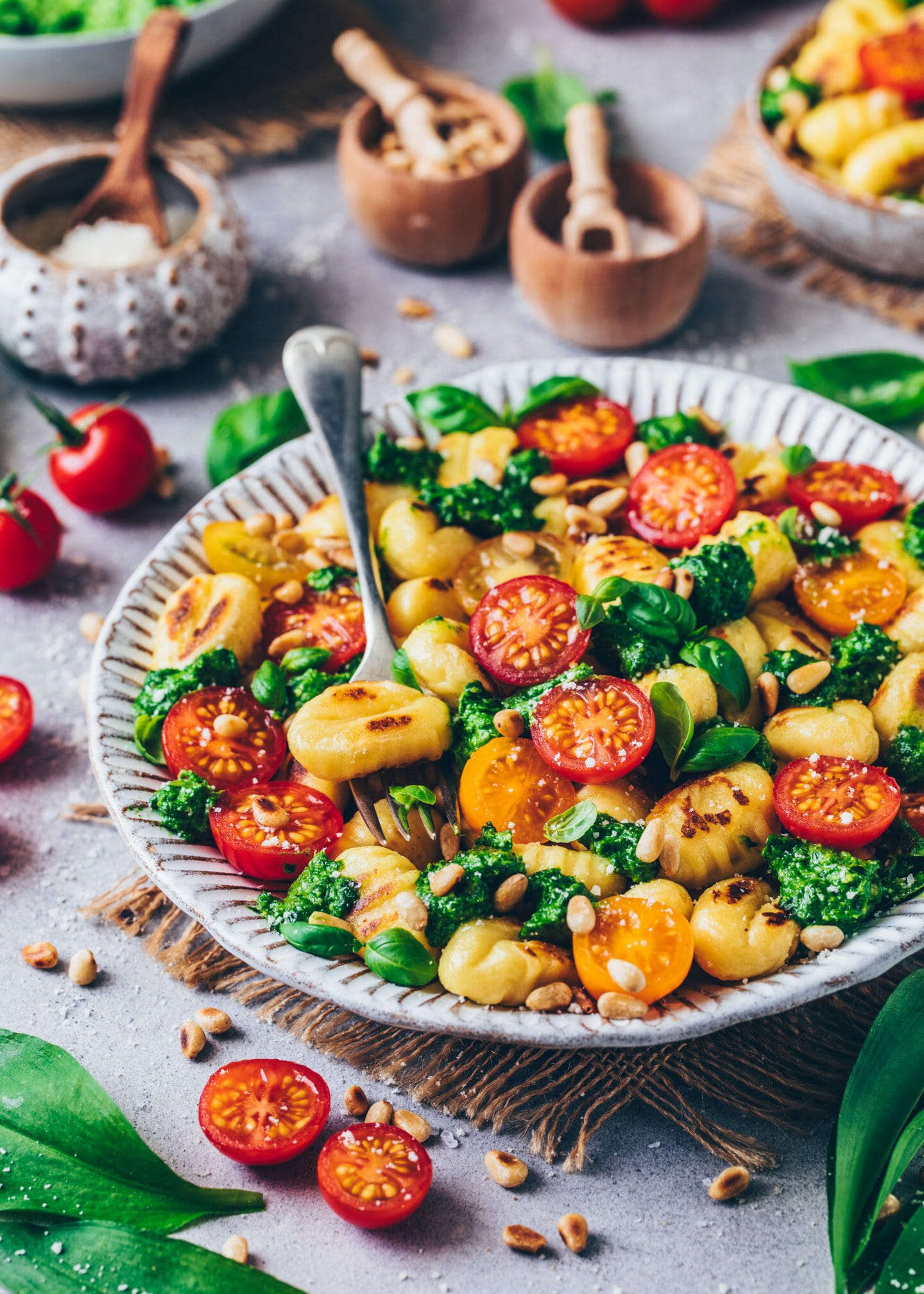 gnocchi with wild garlic, pesto, tomatoes, vegan parmesan cheese, and basil (food photography)