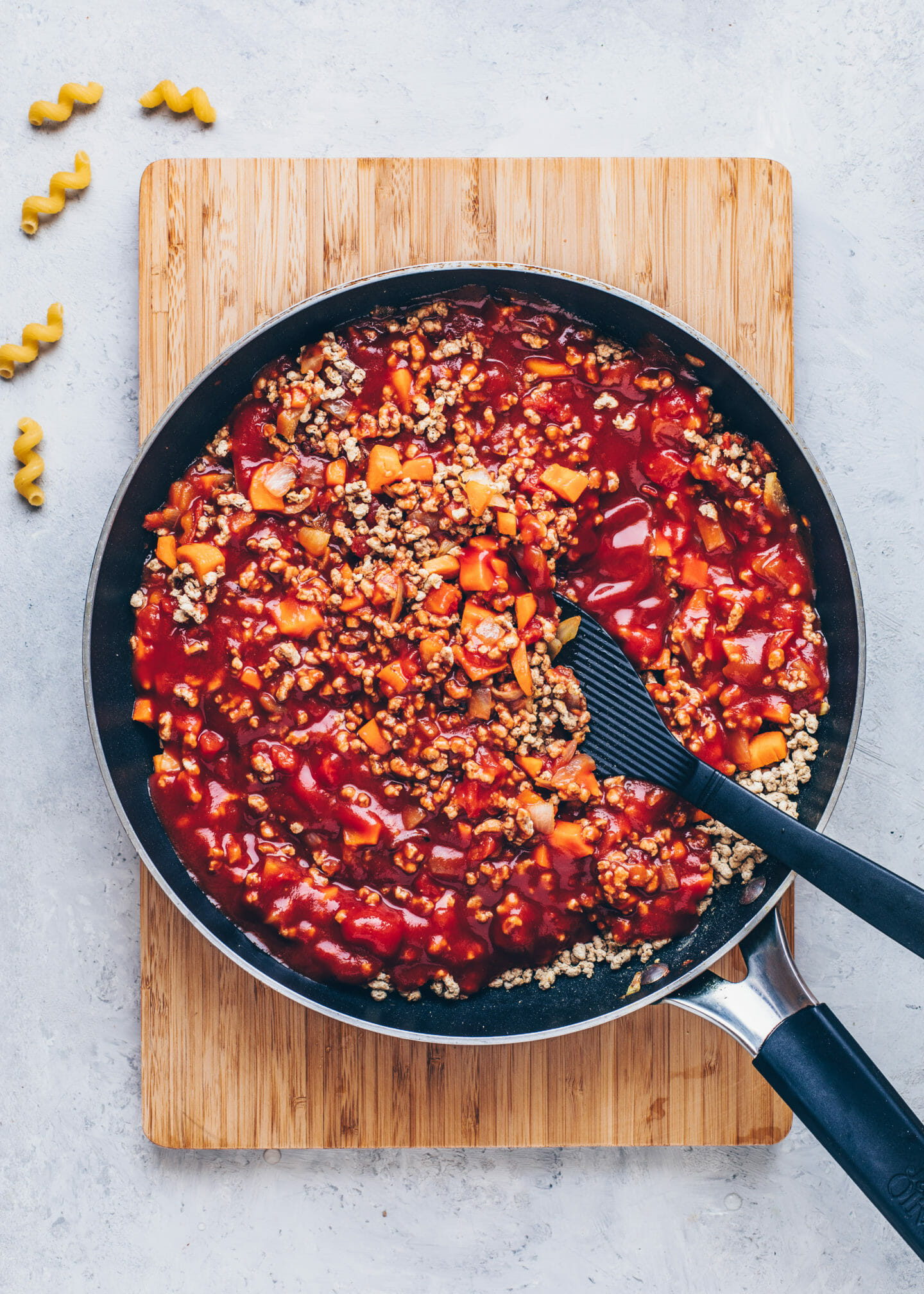 Vegan Bolognese sauce with onions, garlic, carrots, tomatoes and vegan mince meat in a pan