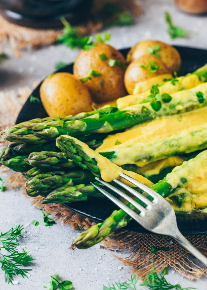 vegan sauce hollandaise with asparagus and boiled potatoes