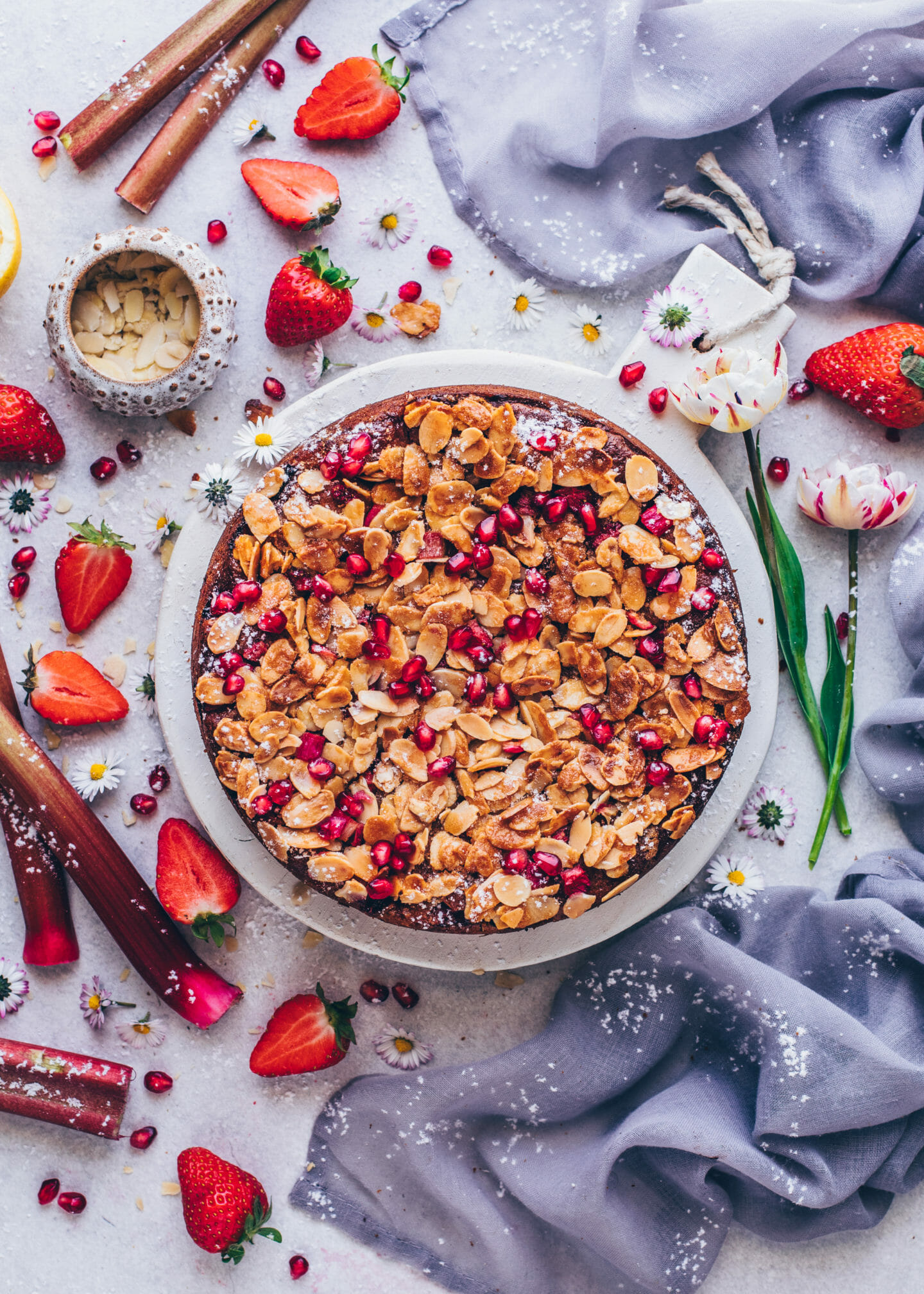 Rhubarb Cake with Strawberries, Almonds and pomegranate (food photography, food styling)