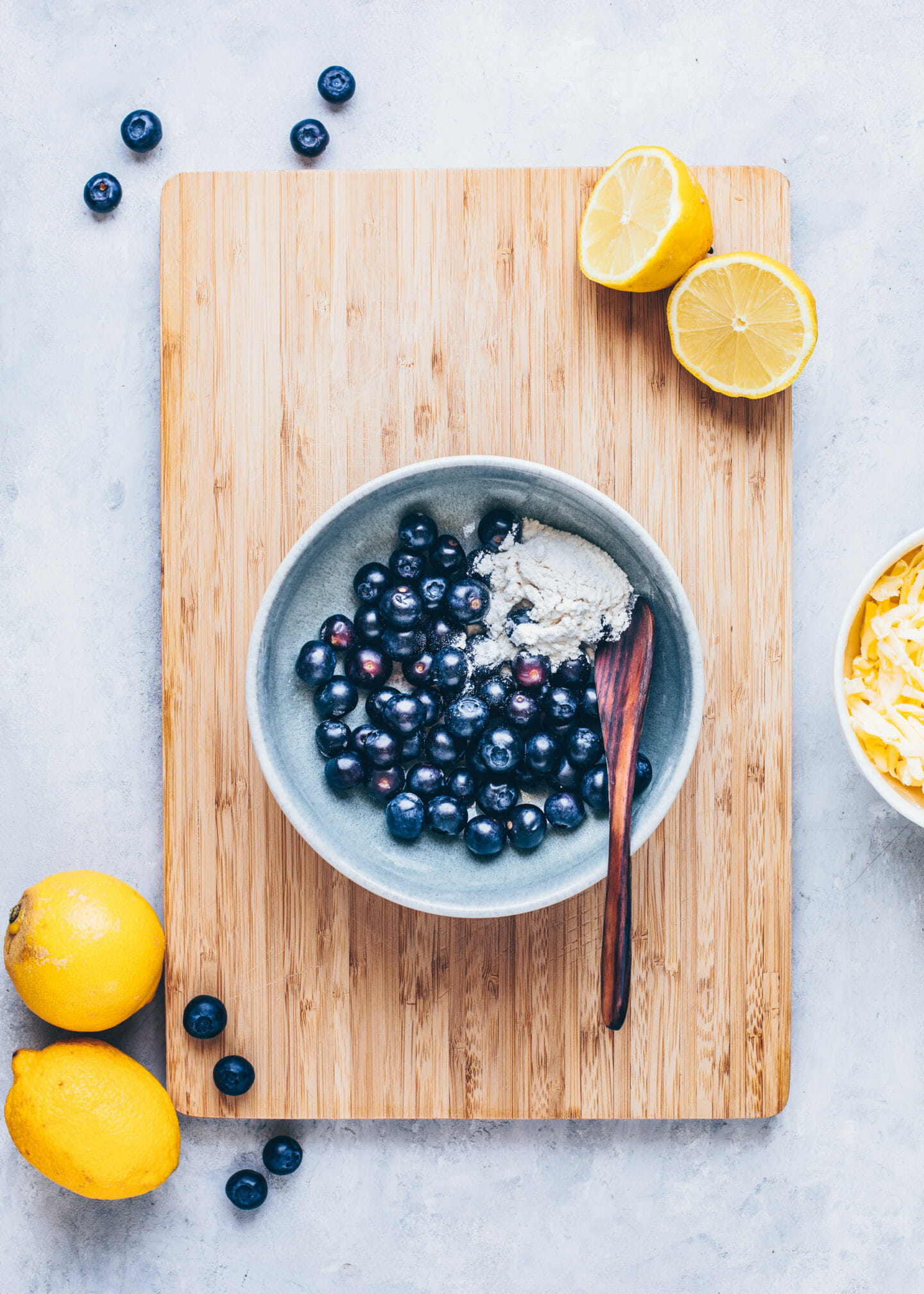 blueberries with cornstarch and flour in a bowl