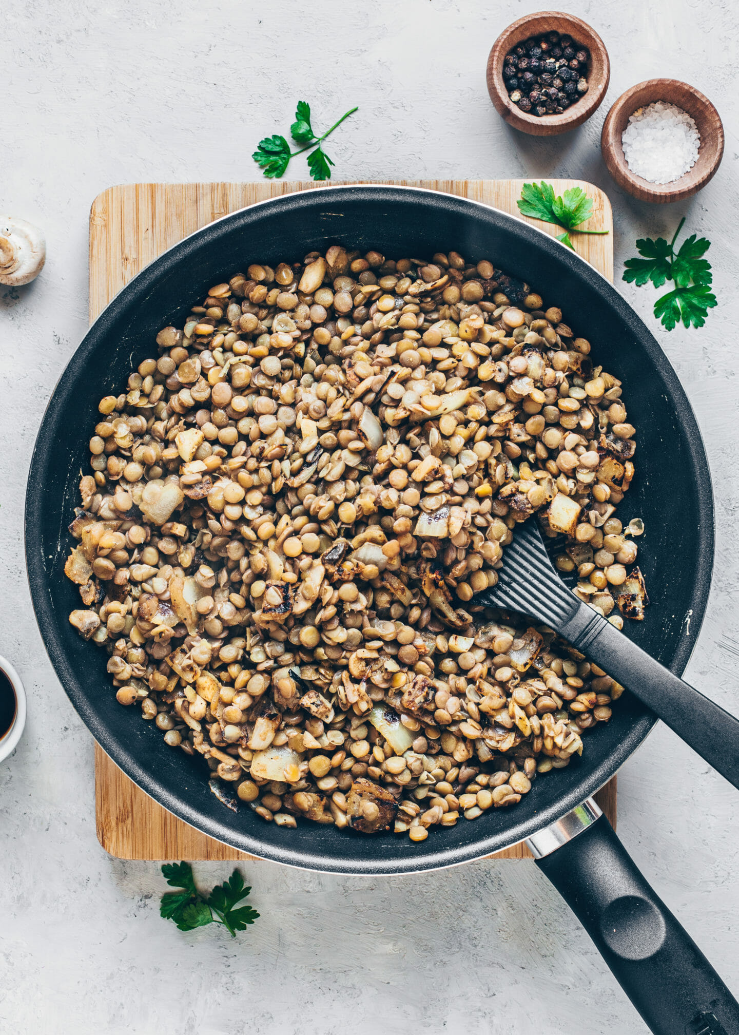 sautéed onions, garlic, and cooked lentils in a pan for no-meat balls