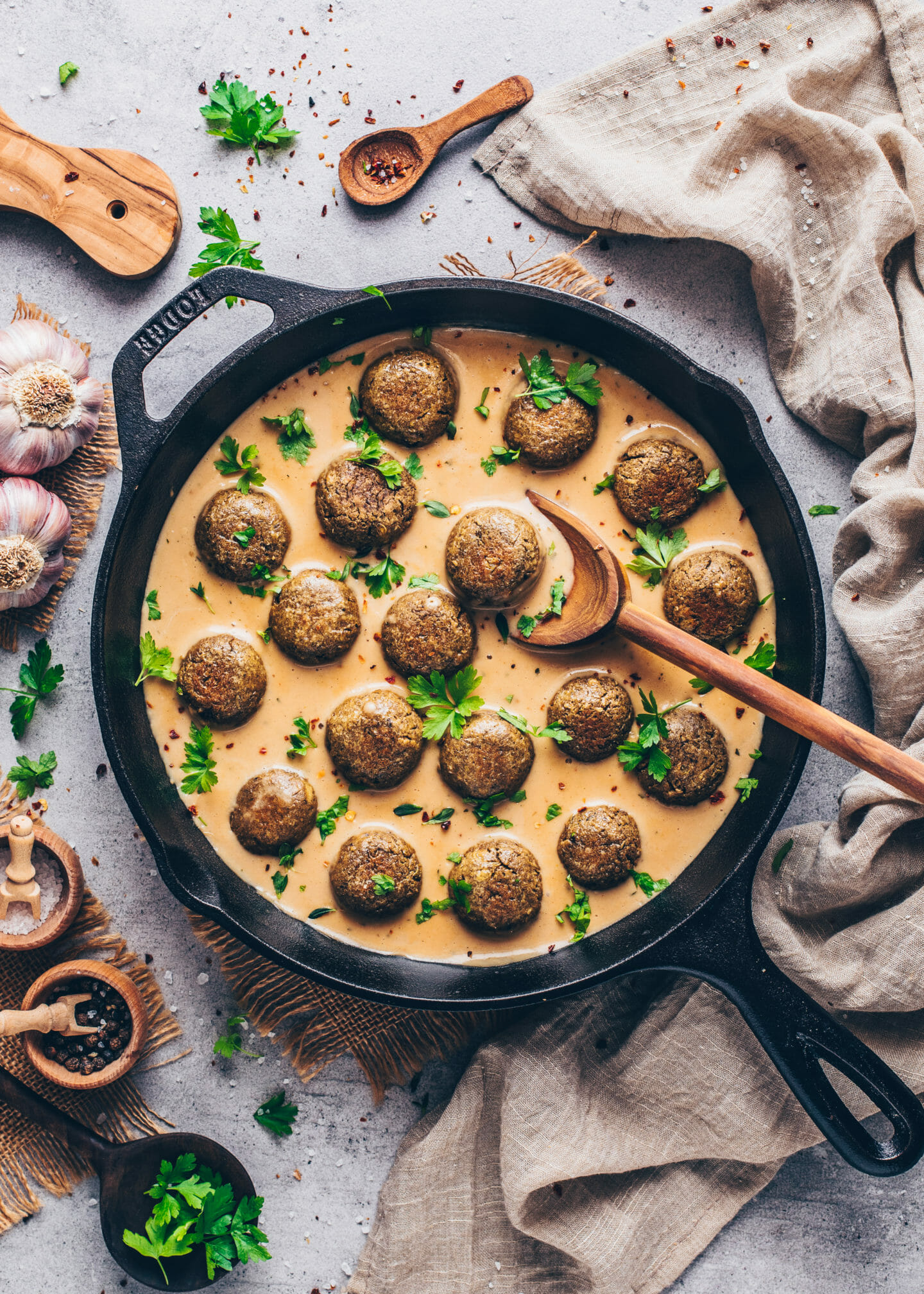 Vegan Swedish Meatballs with creamy gravy in a skillet