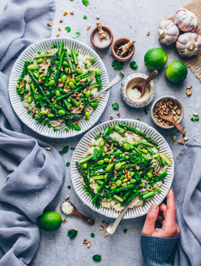 Risotto with asparagus, peas, edamame, pine nuts, parmesan cheese, garlic, and basil (food photography)