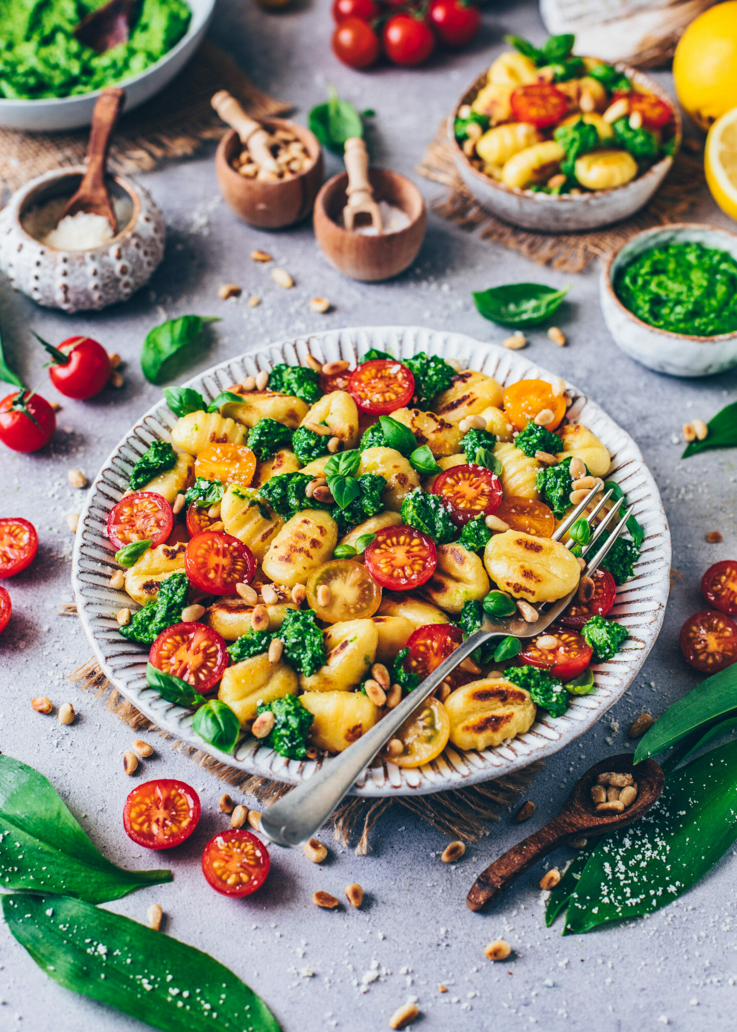 gnocchi with wild garlic, pesto, heirloom tomatoes, parmesan cheese, and basil (food photography)