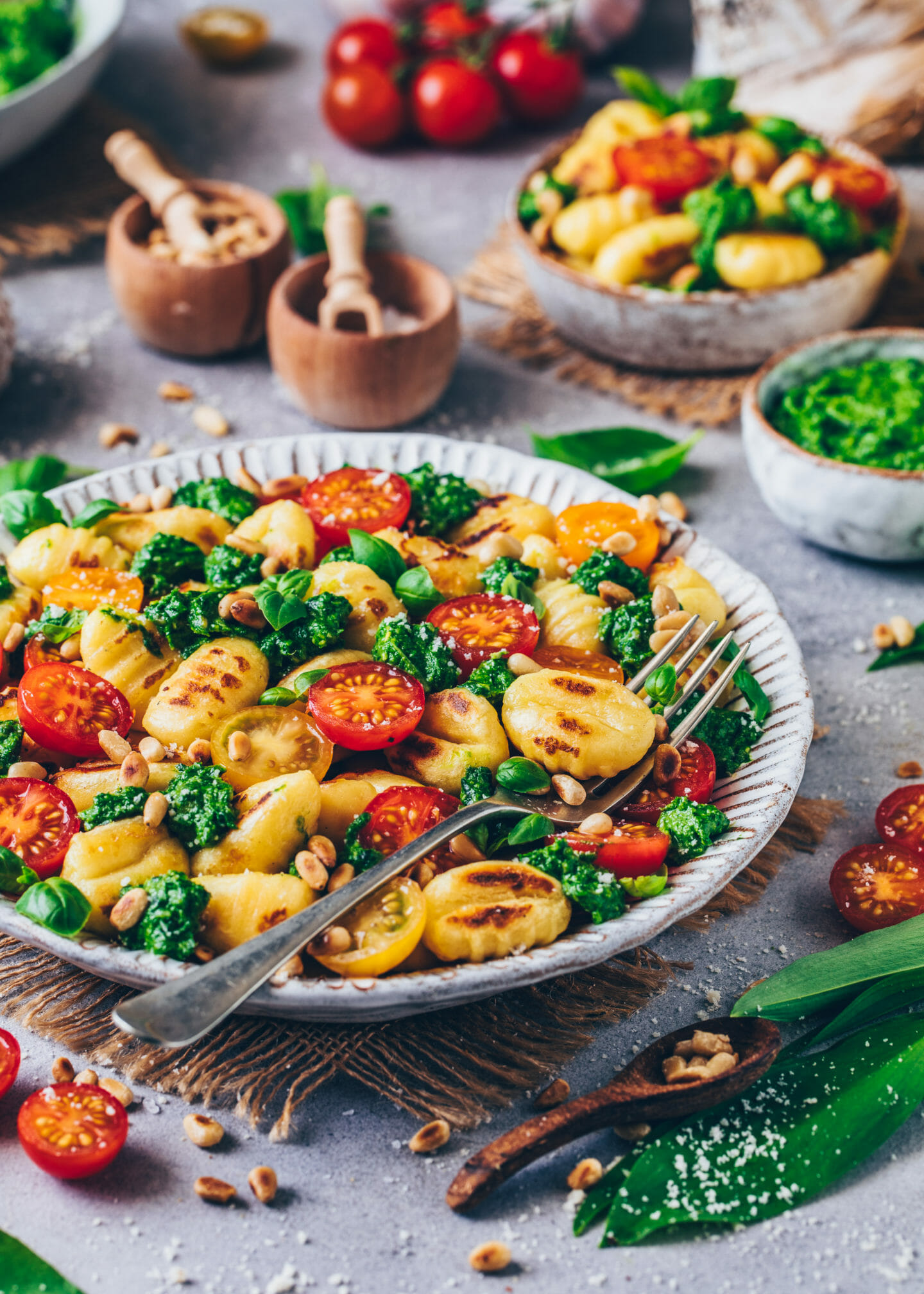 gnocchi with wild garlic, pesto, tomatoes, and basil